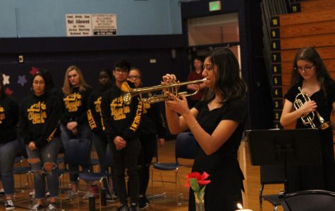 Senior Mayvellyne Segura-Gonzalez plays taps at Veteran's Day Assembly