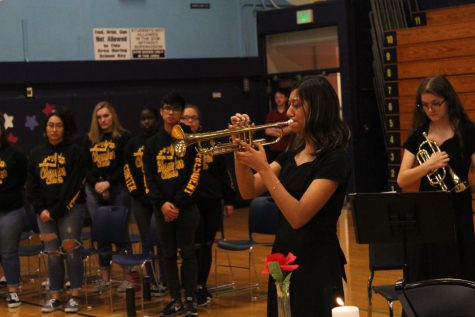 Senior Mayvellyne Segura-Gonzalez plays taps at Veteran